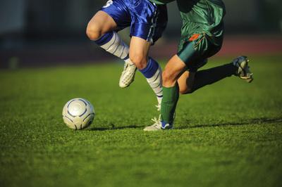 Football Players Contesting for Ball
