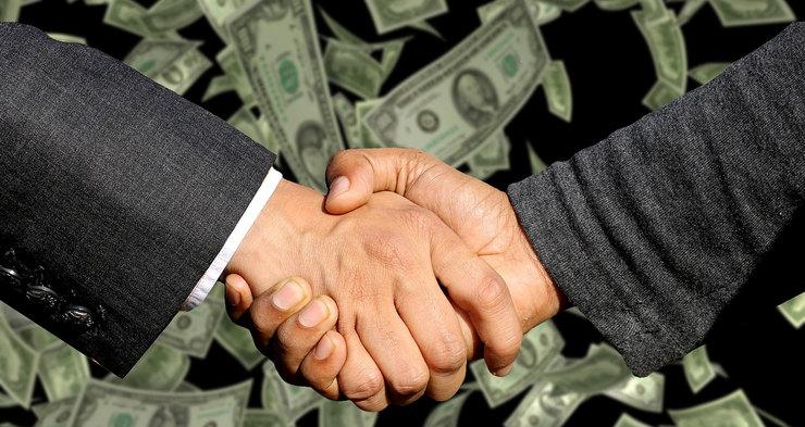 Handshake with Money in Background
