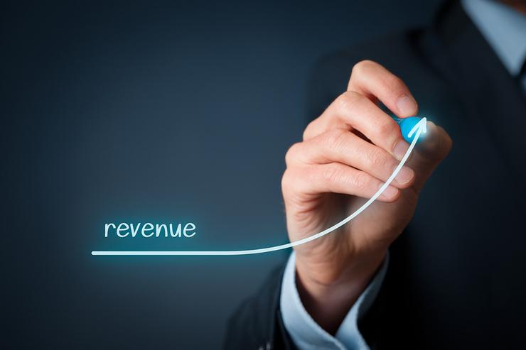 Man in Suit Drawing Increased Revenue