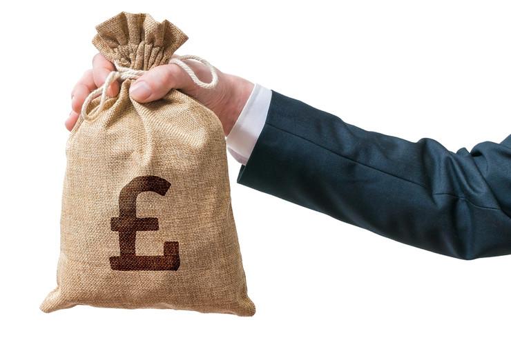 Man Holding Bag of Money