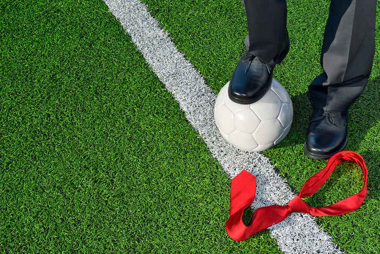 Football Manager and Red Tie on Pitch
