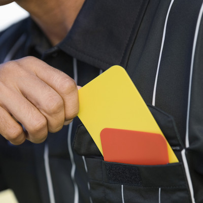 Football Referee Taking Out Yellow Card