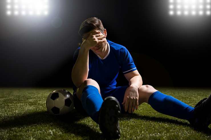 Football Player Looking Disappointed