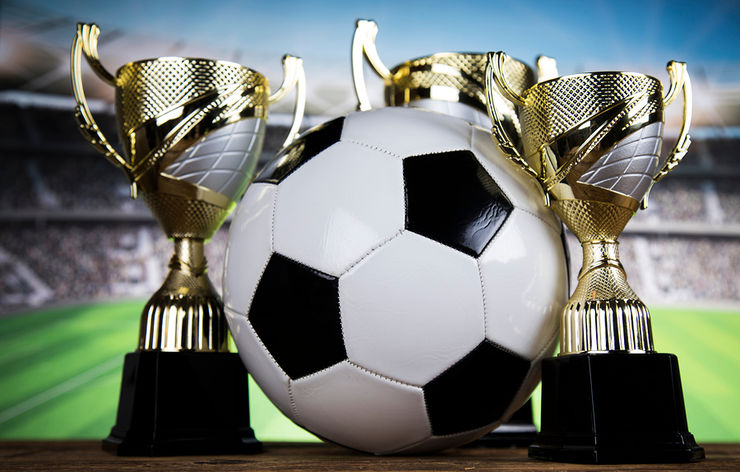 Football with Three Trophies
