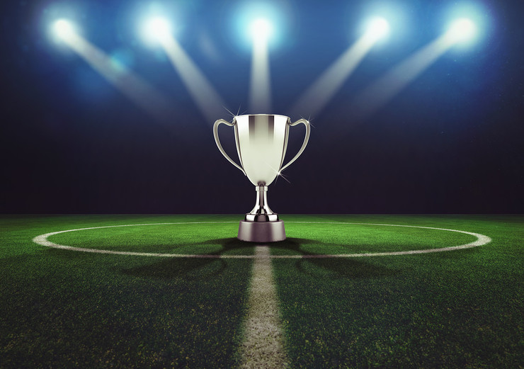 Trophy On Floodlit Football Pitch